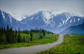 Alaska Highway between WHitehorse and Haines Junction, Yukon, The Kluane Range looms in the distance.